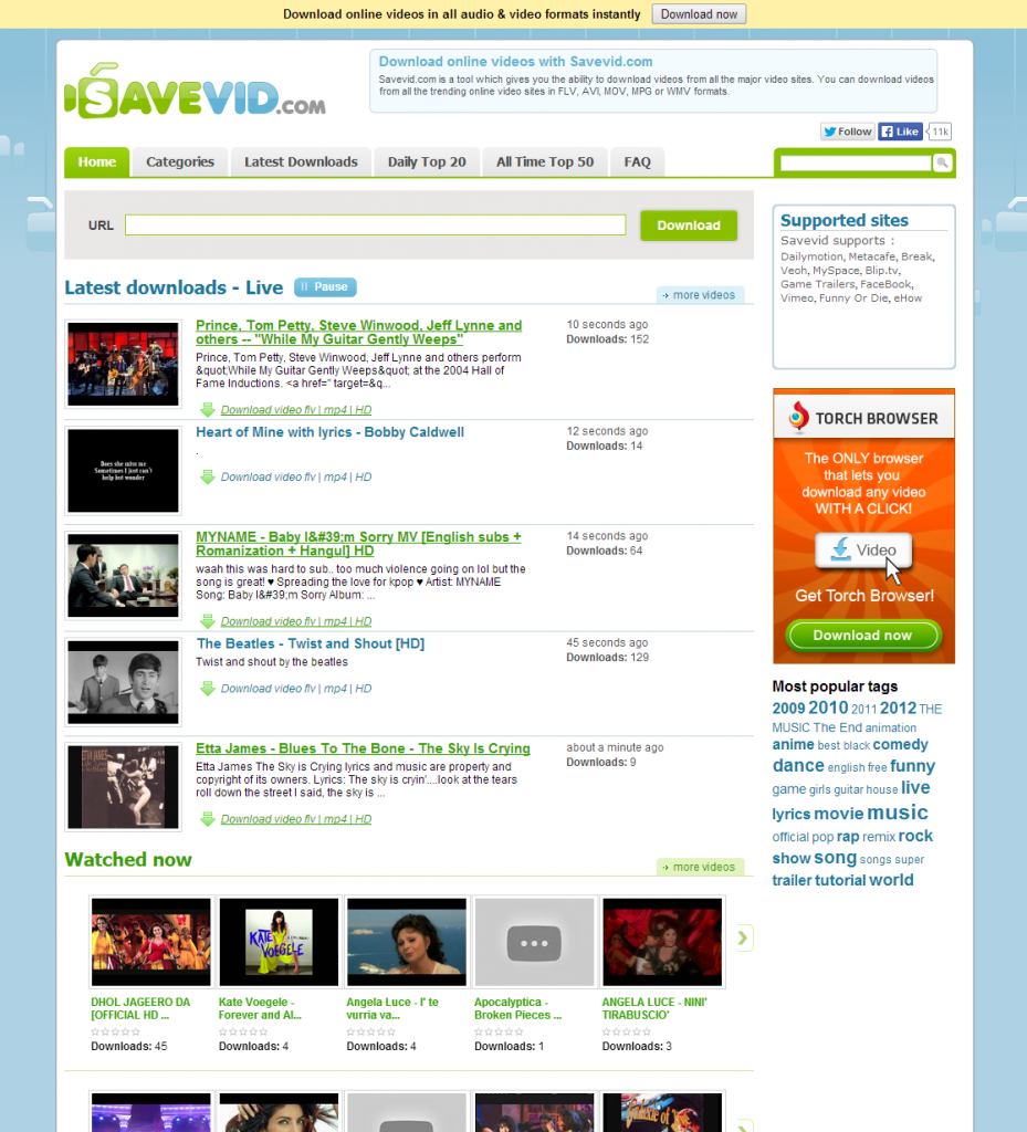 savevid.com download online video and audio - initial screen full of ads and community stuff
